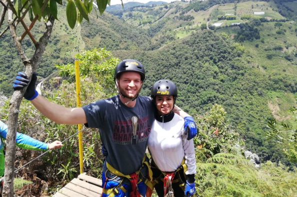 A couple preparing to ride on the zip line
