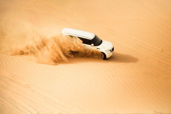 Surfing the dunes of Abu Dhabi in a jeep