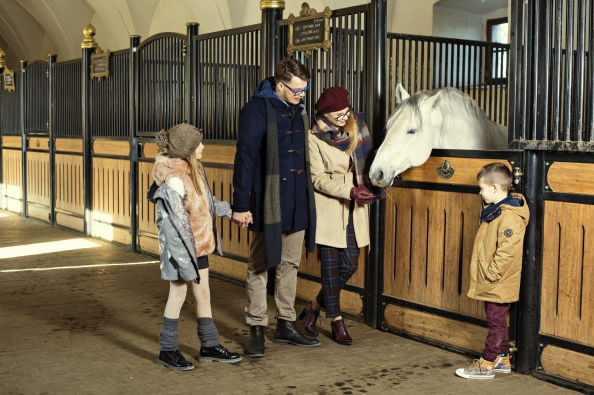 Family visiting the stables