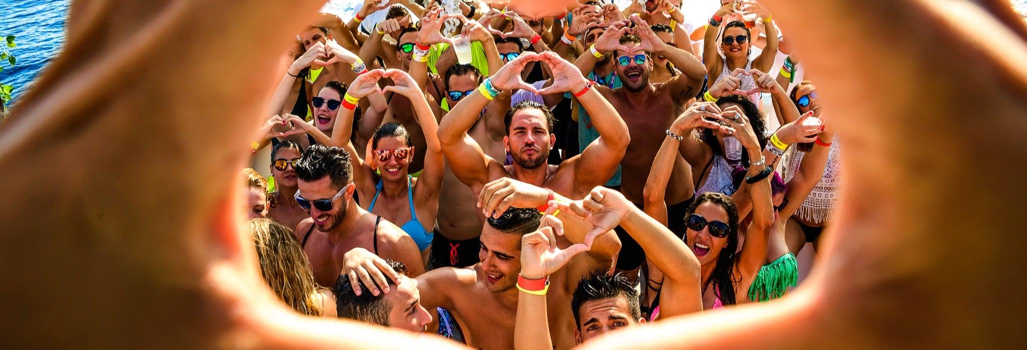 Fiesta en barco al atardecer y discoteca en Playa d'en Bossa