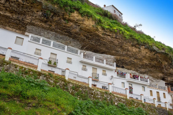 Houses carved into the cliffs in Setenil