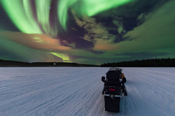 Snowmobile under the Northern Lights