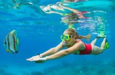 Paseo en casa flotante y snorkel en Roatán