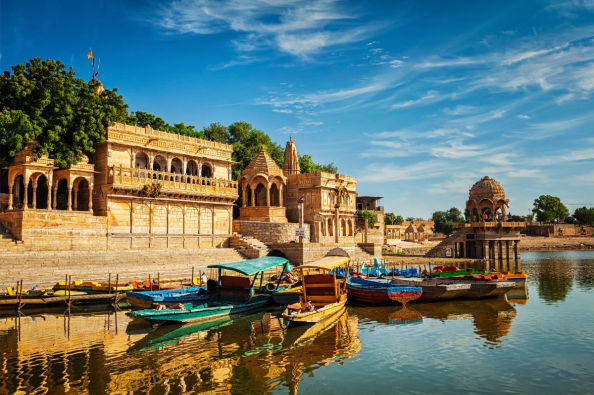 Colourful boats and golden buildings on Gadisar Lake
