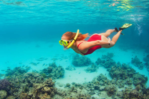 Snorkel in the waters of Enmedio Island