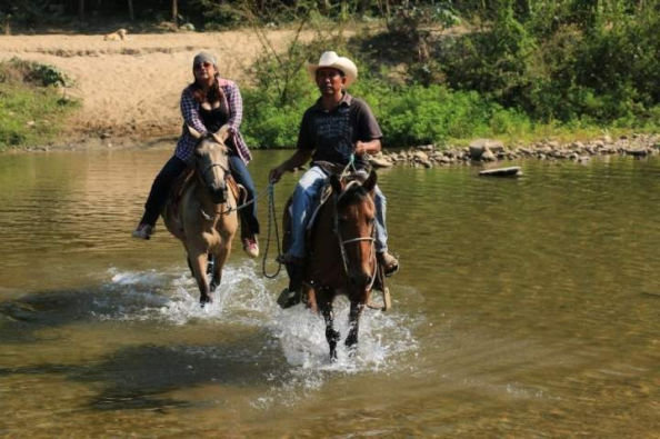 Riding through one of the Maíz River crossings