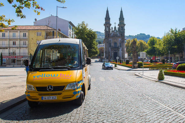 The sightseeing bus next to a historic church