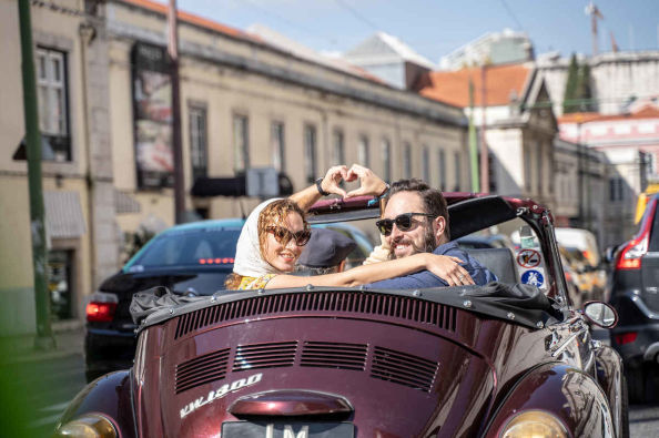Exploring the streets of Lisbon in a VW Beetle